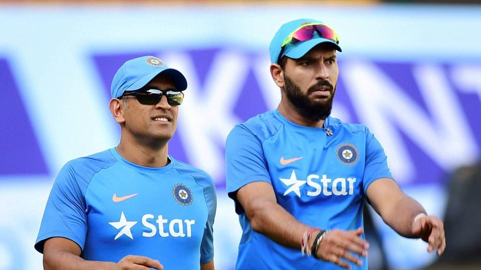 Yuvraj Singh and MSDhoni practice ahead of the deciding Twenty20 International between India and England at the Chinnaswamy stadium. (PTI)