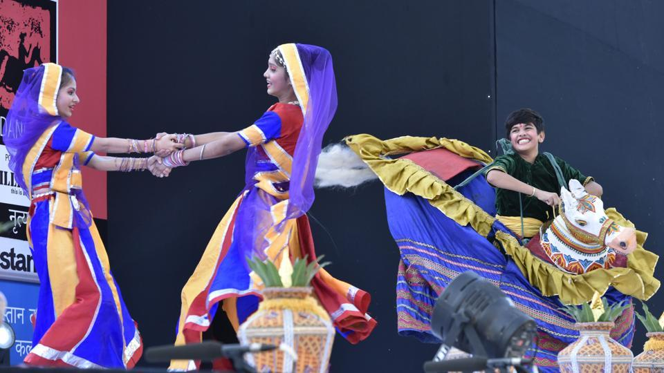 Schoolchildren perform a folk dance at the Kala Ghoda Festival, 2016.