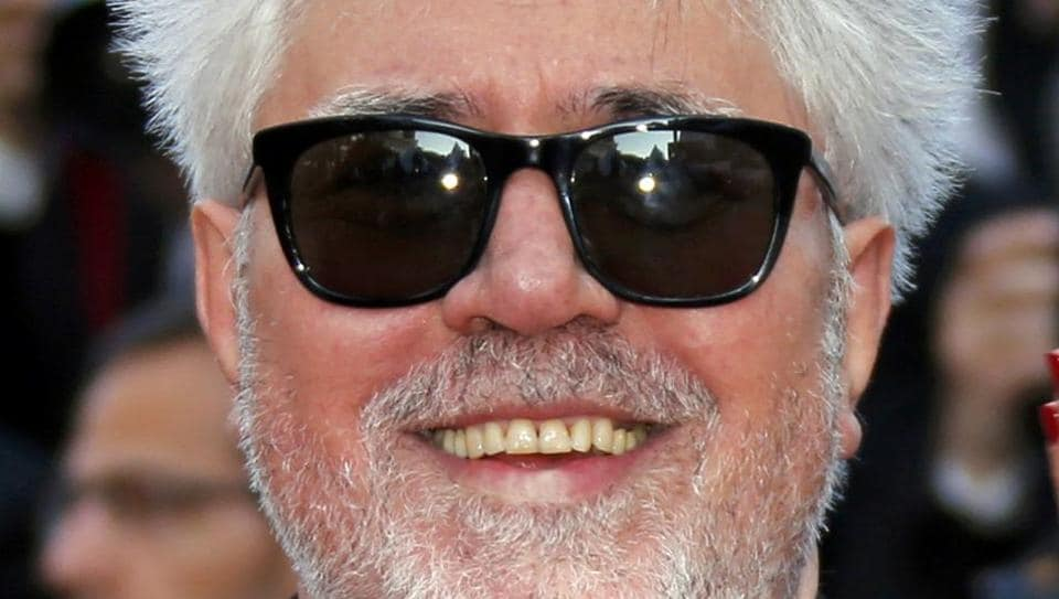 Director Pedro Almodovar poses on the red carpet as he arrives for the screening of the film Julieta in competition at the 69th Cannes Film Festival in Cannes.