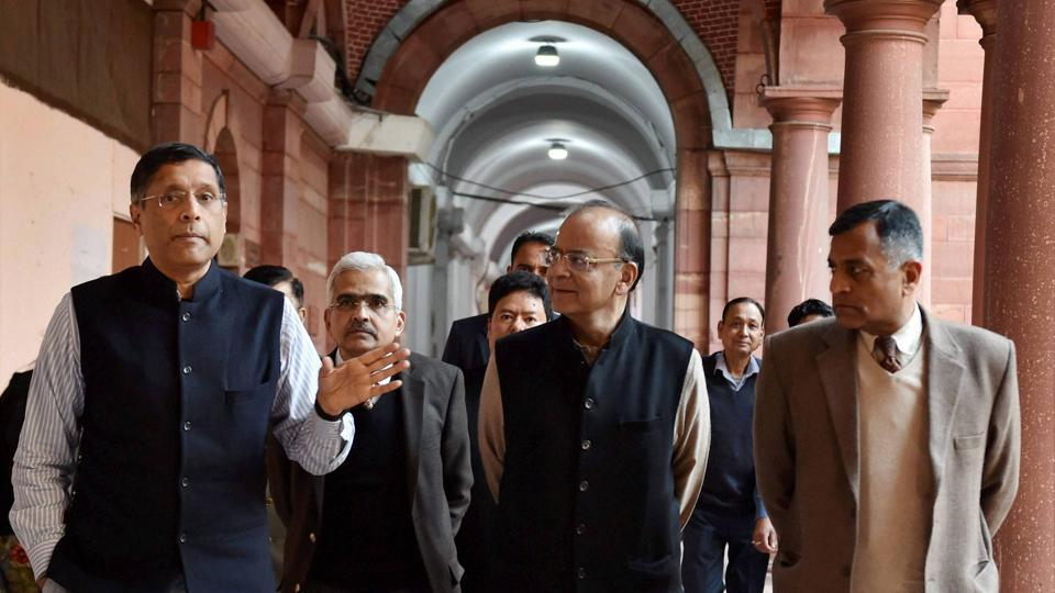 Union finance minister Arun Jaitley with chief economic adviser Arvind Subramanian (L) and economic affairs secretary Shaktikanta Das (2nd L) at North Block in New Delhi . Despite the government's claims about rapid GDP growth, indicators such as credit growth, private investment, export performance and job creation point to a weaker economy than what headline numbers suggest