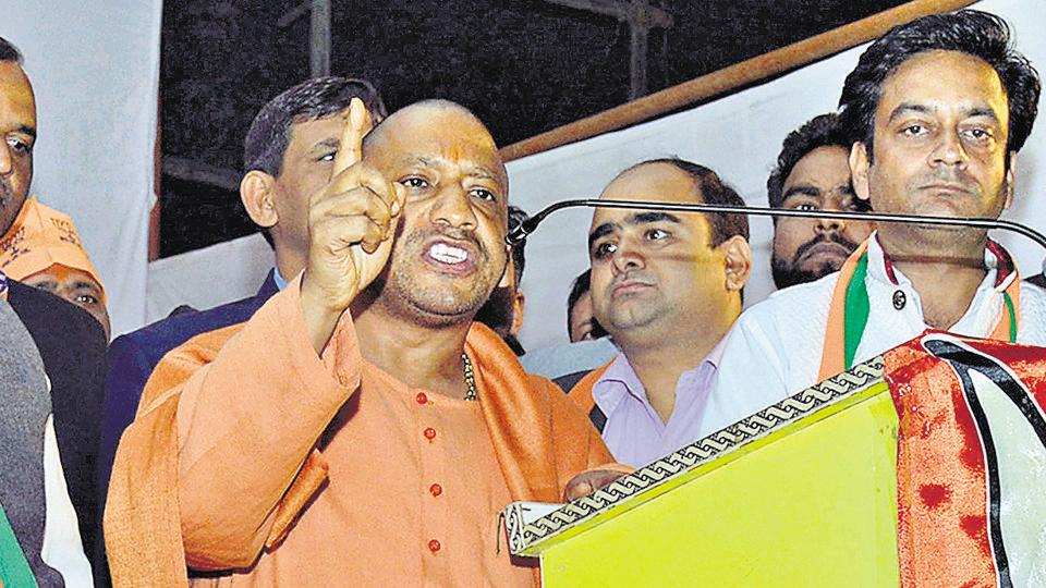 BJP leader Yogi Adityanath (in saffron kurta) at an election rally in Ghaziabad  on Monday, January 30, 2016.  At another public meeting in Bulandshahr, he endorsed USPresident Trump's immigration curbs on travellers from seven Muslim-majority countries.