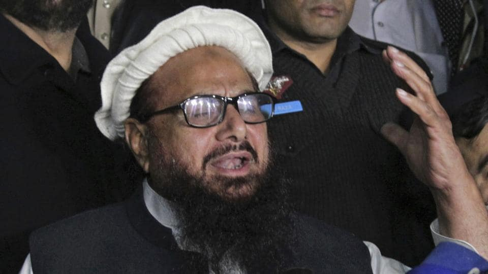 Hafiz Saeed addresses his supporters in Lahore on Monday.