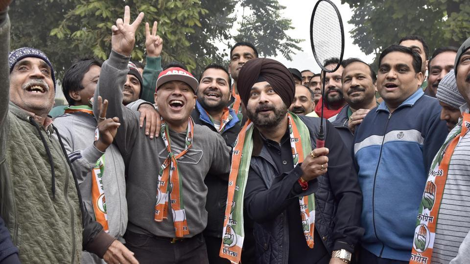 Congress' star campaigner Navjot Singh Sidhu, who is contesting from Amritsar East segment, playing badminton with residents during campaigning.