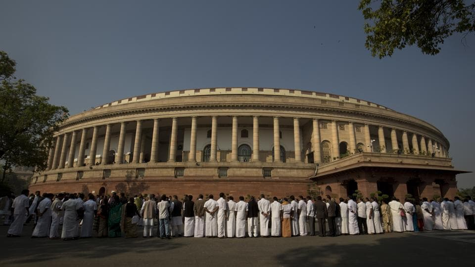 Indian lawmakers from opposition parties form a human chain outside the parliament building during a protest against the government demonetizing high-value bills in New Delhi on November 23, 2016.