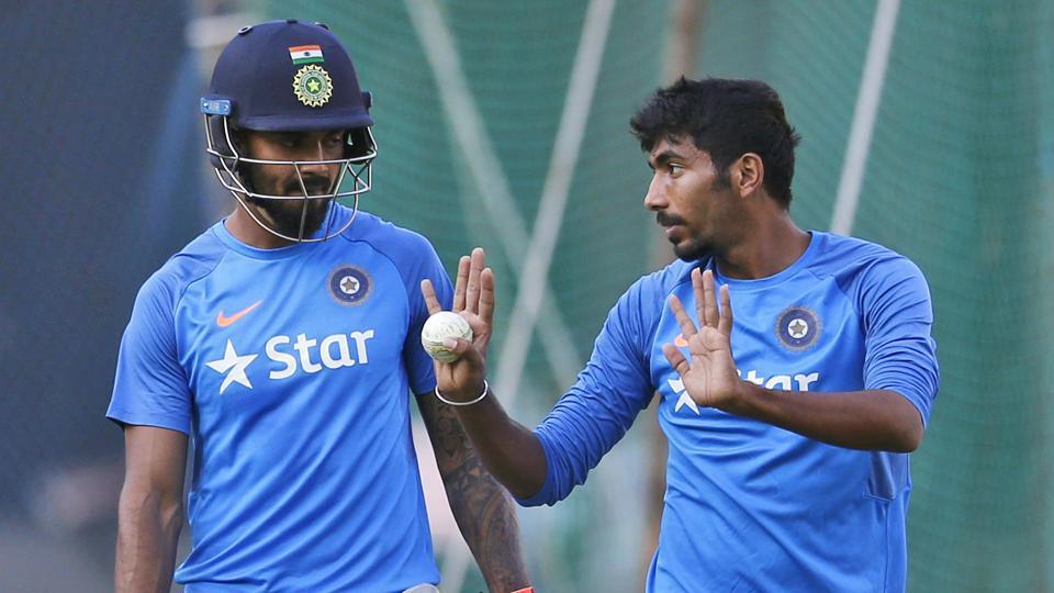 Jasprit Bumrah (R) interacts with Lokesh Rahul ahead of India's third Twenty20 International against England.