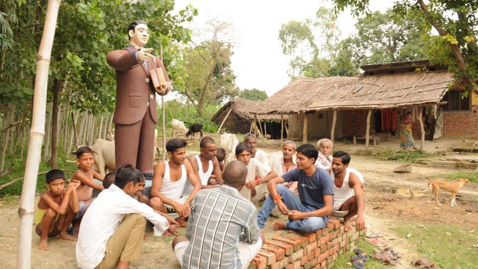 Members of  Dalit community  holding a meeting near Ambedkar statue in Deokali village in Lakhimpur Kheri district,  in Lakhimpur, August 19, 2016.
