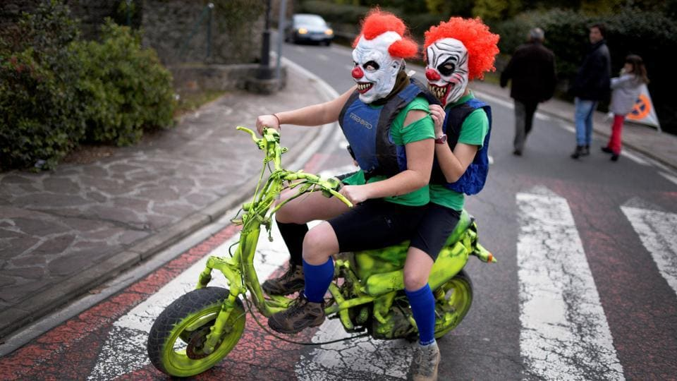 Masked revellers ride a motorbike during carnival celebrations in Ituren, northern Spain on Monday.  (Reuters photo)