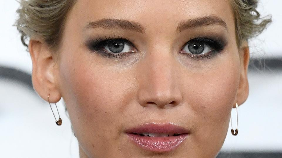 Jennifer Lawrence poses during a photocall to promote the forthcoming film Passengers in London.