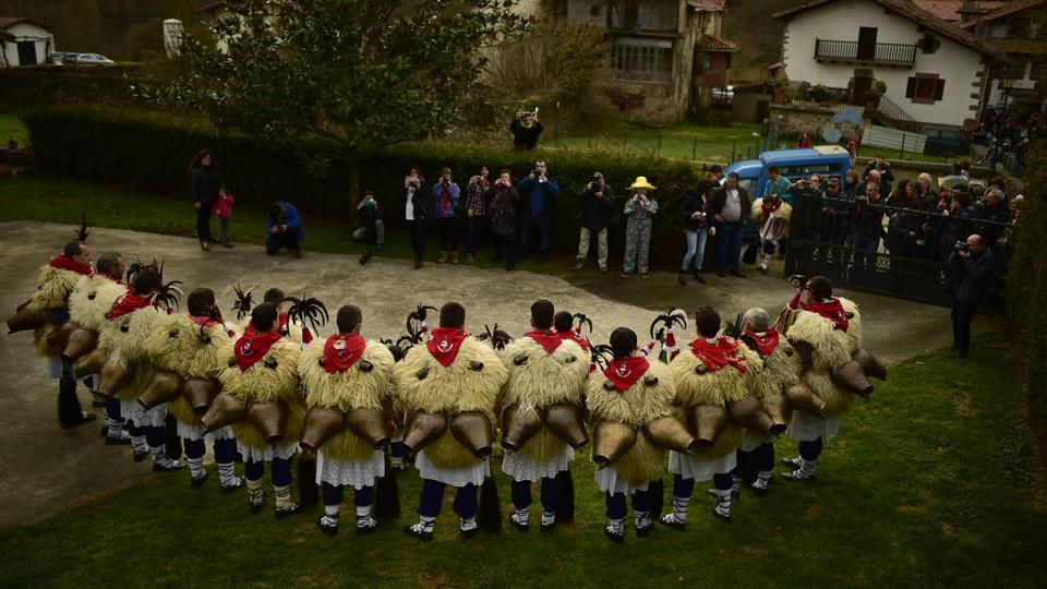 A group of Joaldunaks, called Zanpantzar, pose before the carnival between the Pyrenees villages of Ituren and Zubieta, northern Spain on Monday. Bell carrying dancers known as Joaldunak perform a ritual dance to ward off evil spirits and awaken the coming spring.  (AP photo)