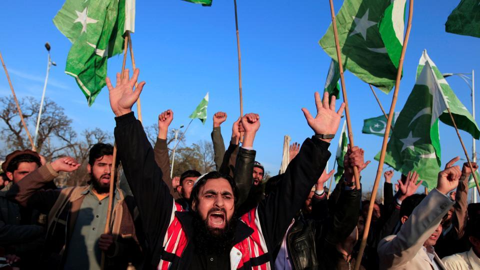Supporters of Islamic charity organization Jamaat-ud-Dawa (JuD), chant slogans to condemn the house arrest of Hafiz Muhammad Saeed, chief of (JuD), during a demonstration in Islamabad, Pakistan, January 31.