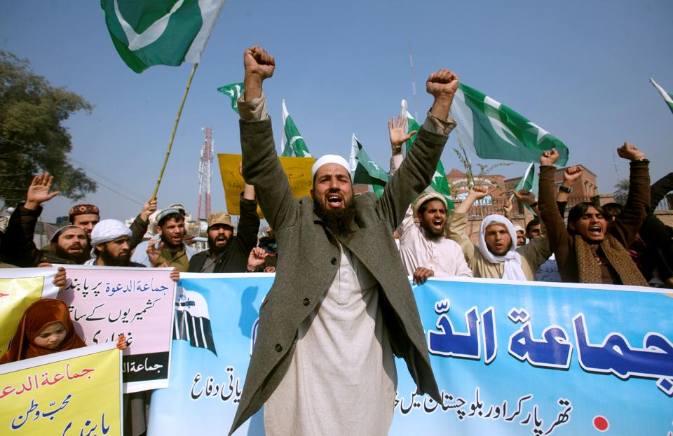 Jamaat-ud-Dawa (JuD) supporters in Peshawar chant slogans to condemn the house arrest of their chief Hafiz Saeed.