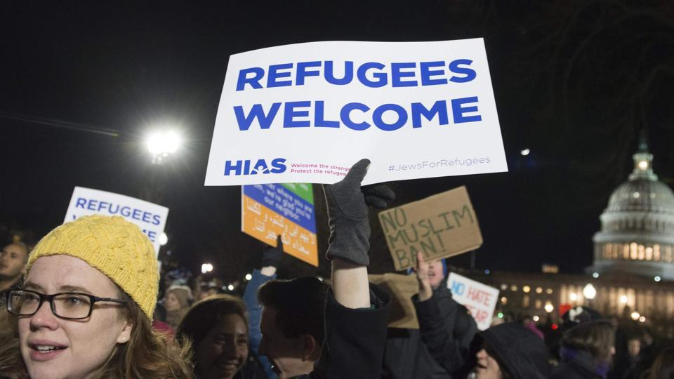 Demonstrators protest against US President Donald Trump's ban on travellers from seven countries, in Washington, DC.