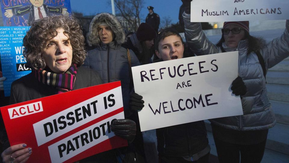 Demonstrators protest against US President Donald Trump and his administration's ban of travellers from seven countries, during a rally outside the US Supreme Court in Washington.