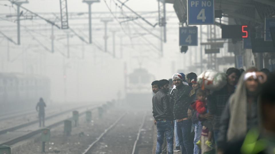 Passengers wait for their train at Hazrat Nizamuddin railway station.