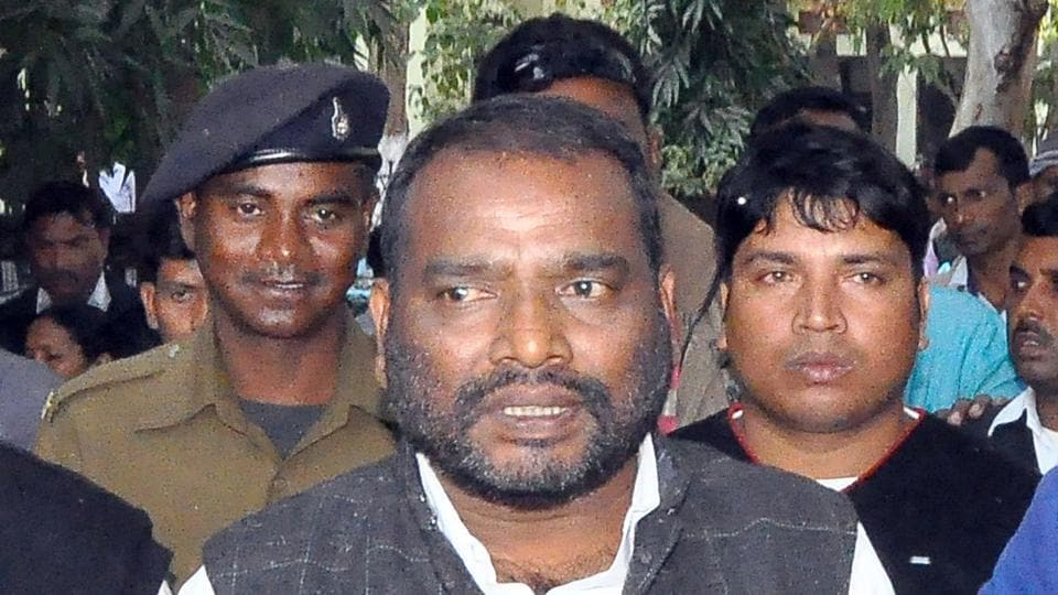 Former Jharkhand minister Harinarayan Rai comes out from a court after his conviction in a case in Ranchi on December 14, 2016.
