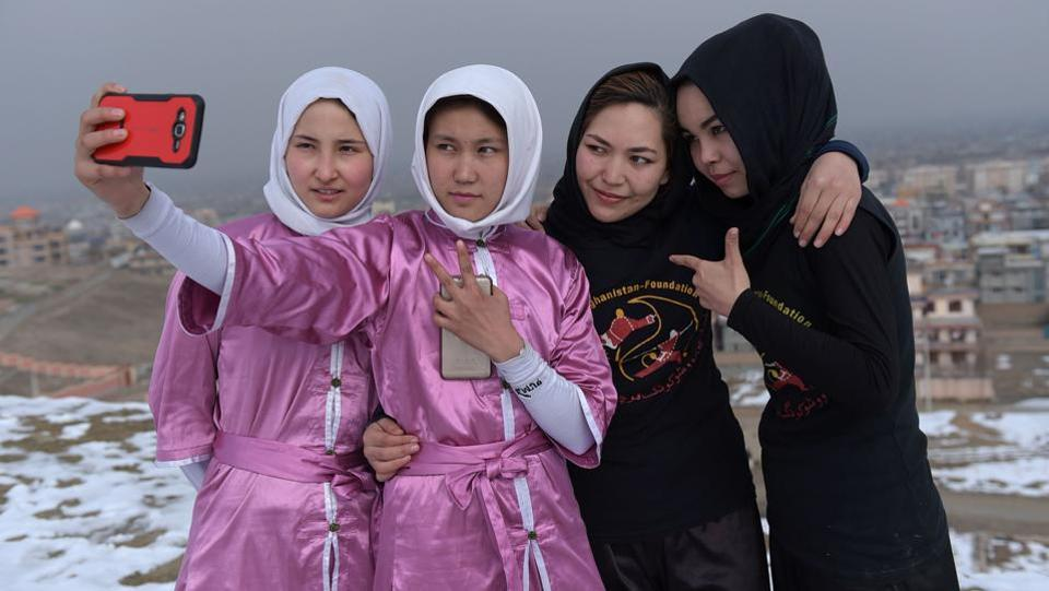 Girls of the Wushu martial arts group take a 'selfie'.  (AFP Photo)