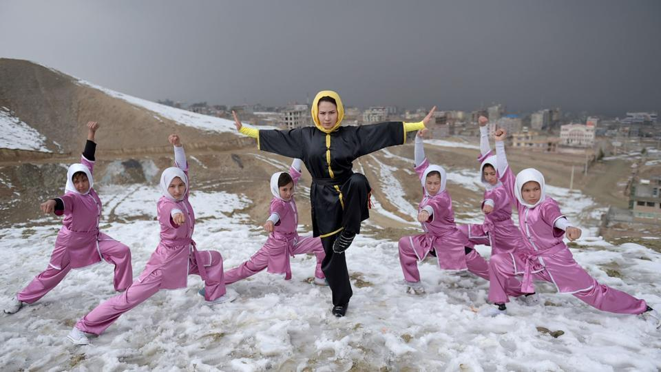 Afghan members of a Wushu martial arts group led by trainer Sima Azimi (centre) pose for a photograph at the Shahrak Haji Nabi hilltop.  (AFP Photo)