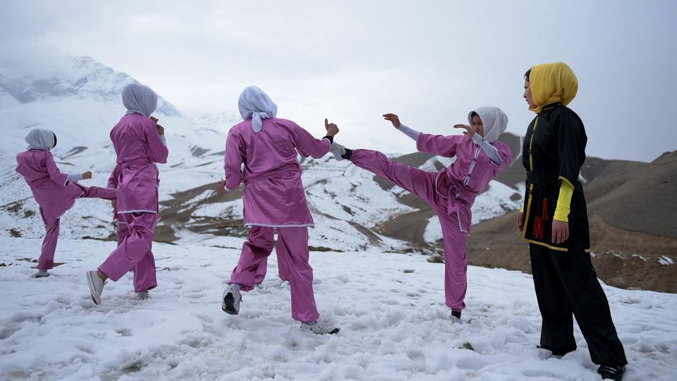 20-year-old Azimi trains  dozens of Afghan girls at a Wushu club in Kabul. (AFP Photo)