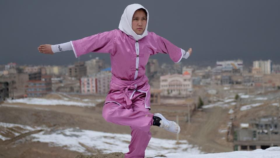 A girl poses for a photograph at the Shahrak Haji Nabi hilltop, overlooking Kabul.  (AFP Photo)