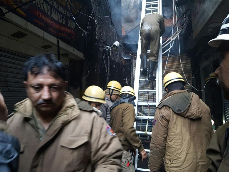 Firemen at Moti Bazar in Chandni Chowk where at least 15 shops were gutted in an early morning blaze on Wednesday.