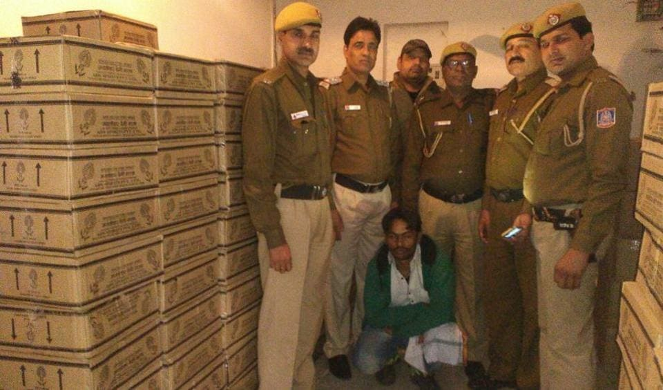 Delhi Police found at least 300 cartons each containing 50 quarter bottles of illicit liquor made in Haryana.
