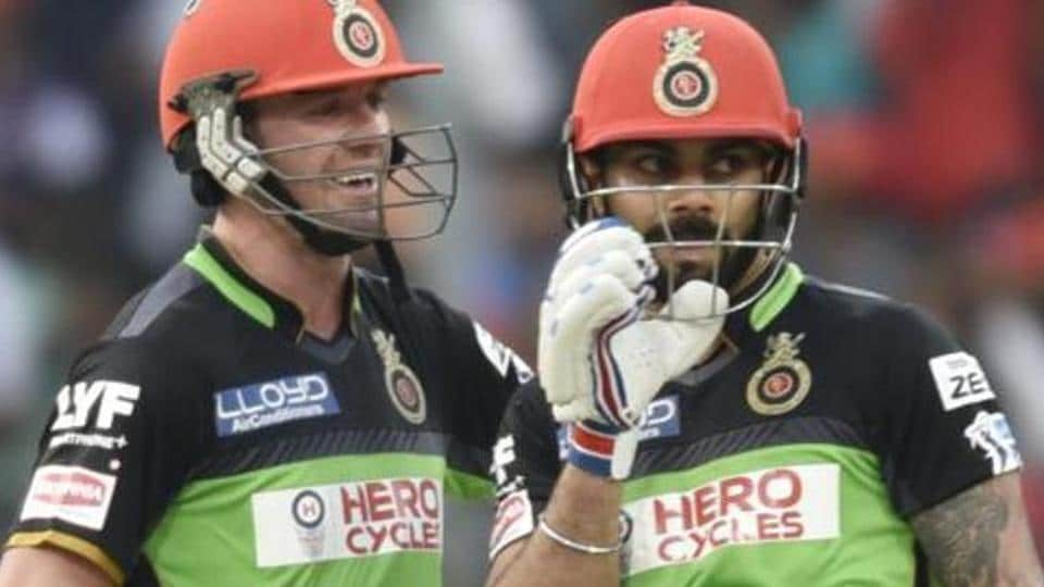 Royal Challengers Bangalore's Virat Kohli and AB De Villiers during an IPL match against Gujarat Lions at Chinnaswamy Stadium in Bangalore last year.