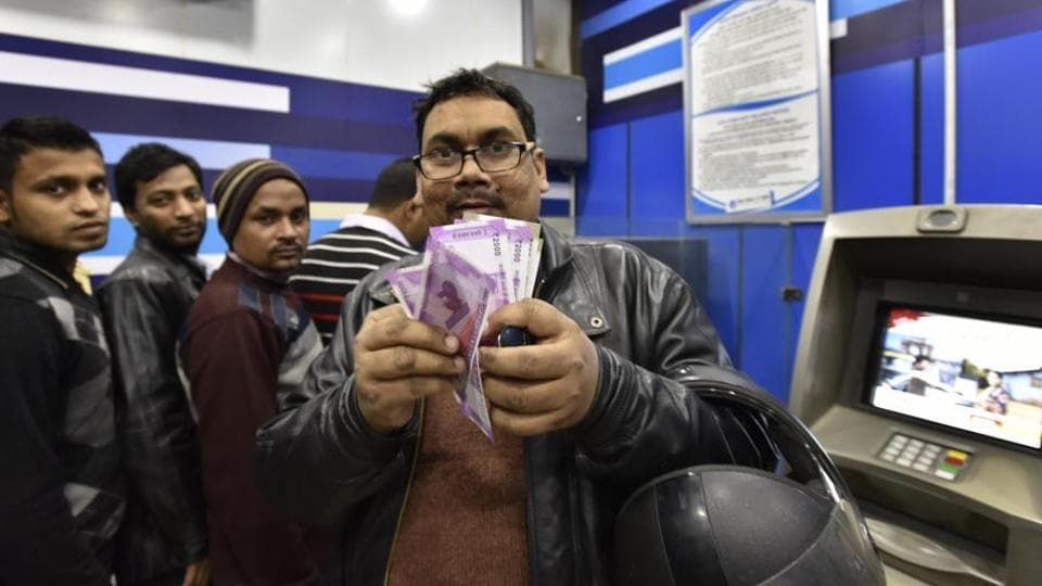 People standing  in a queue outside an  ATM  in New Delhi, India, on Sunday, January 8, 2017.
