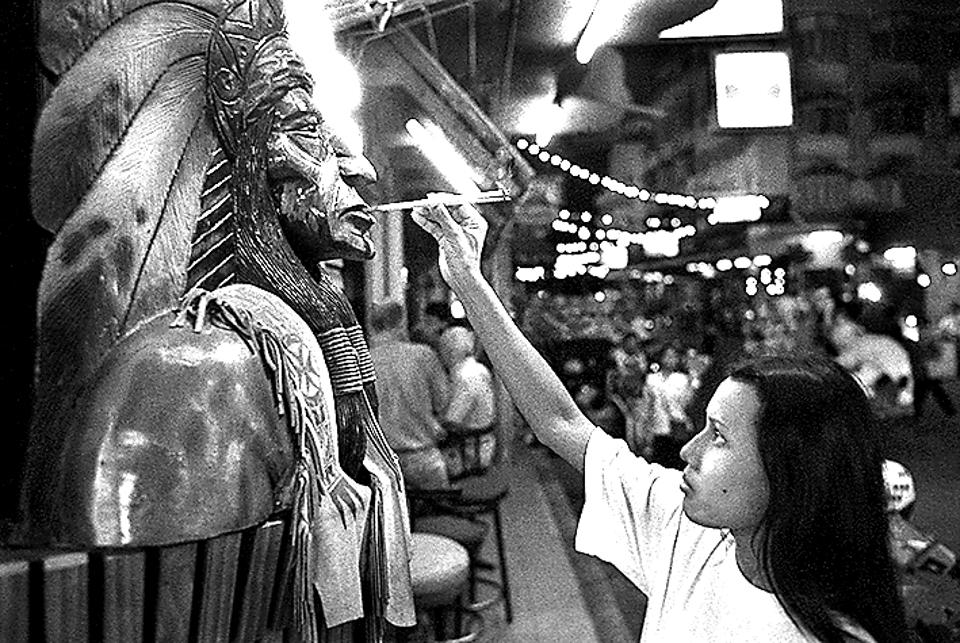 On 1st January, 2000, a bar girl lights some incense to bring good luck and fortune to the go-go bar where she works.