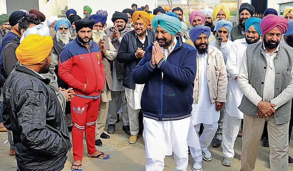 Congress candidate Balbir Singh Sidhu greeting people during his election campaign at Manakpur village near SAS Nagar.