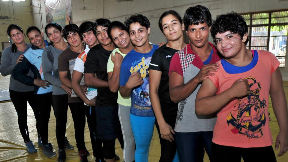 Women wrestlers during a practice session at a wrestling training center in Rohtak, Haryana. The sex ratio at birth (SRB), according to sample registration system (SRS) statistical report 2012, ranked Haryana at the bottom amongst all states with an SRB of 857.
