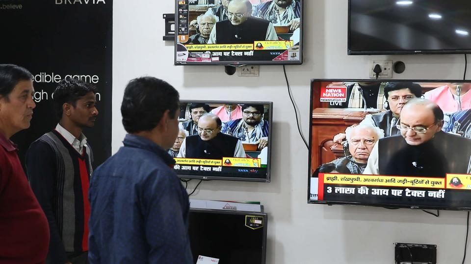 People watch the Union Budget being presented by finance minister Arun Jaitley at an electronics showroom in Jaipur, Rajasthan on Wednesday.