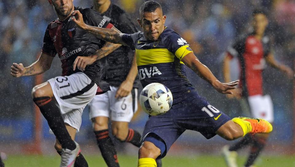 Carlos Tevez (R) will go to Chinese Super League club Shanghai Shenhua from Boca Juniors.