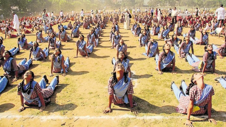 Students performing Surya Namaskar, a form of Yoga, at Mulund Sambhaji ground in Mumbai.