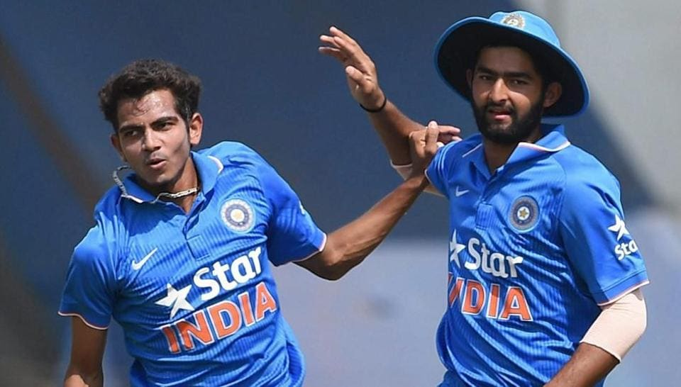 India U-19's player Kamlesh Nagarkoti (L) and Shiva Singh celebrate the dismissal of an England U-19 batsman.