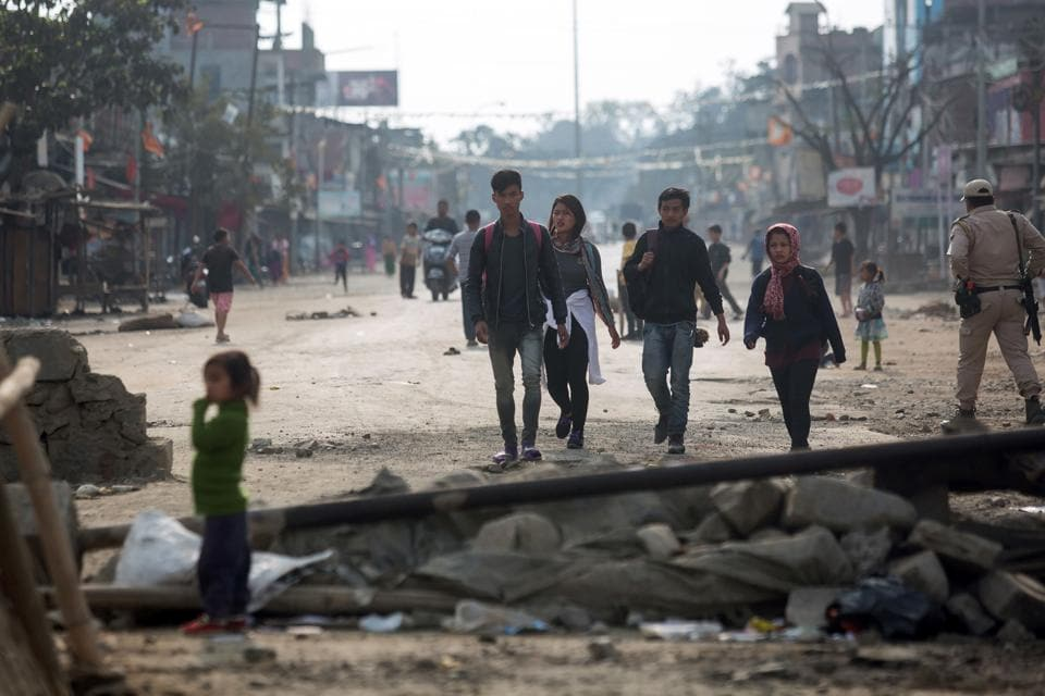 Pedestrians walk past roadblocks on the outskirts of Imphal during the ongoing economic blockade led by Naga militant groups.