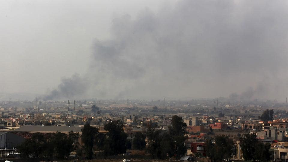 Smoke rises from the western side of Mosul, in Iraq.