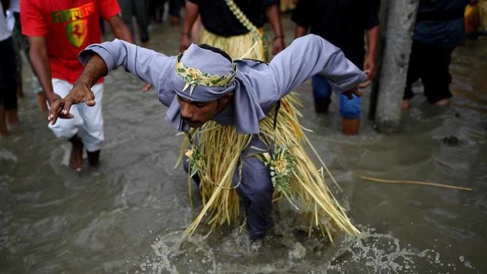 The Puja Pantai Celebration is an annual ritual of the Malaysian Mah Meri tribe to appease the spirits of the sea. They are the descendants of seafarers who lived through fishing and trading. (Manan VATSYAYANA / AFP)
