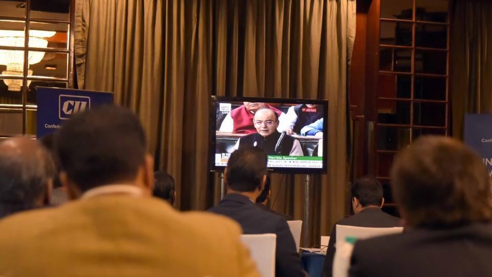 CII officials watch the budget live on TVat a hotel in Jaipur on Wednesday.