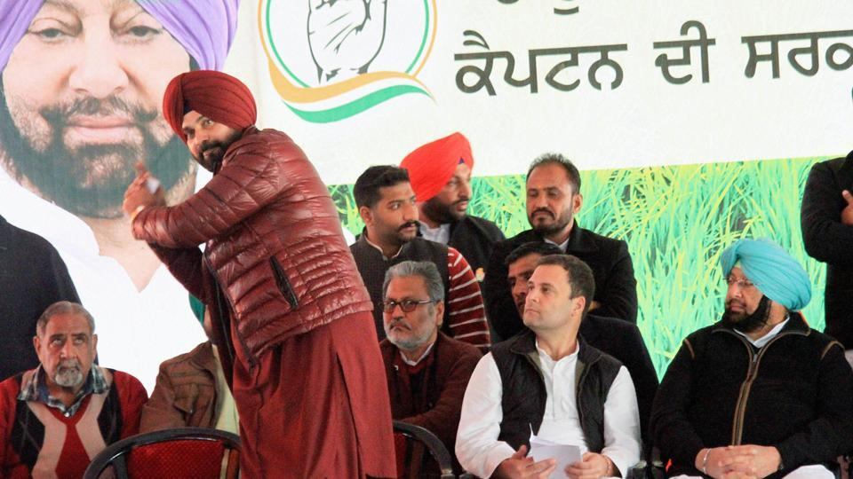 Navjot Singh Sidhu  with Congress vice-president Rahul Gandhi and state party president and chief minister candidate Captain Amarinder Singh at an elecation rally in Jalalabad Fazilka district, Punjab, on January 28, 2017.