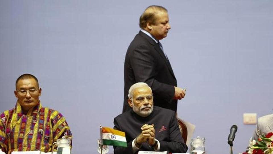 File photo of Bhutan Prime Minister Tshering Tobgay (left), Indian Prime Minister Narendra Modi (centre), and Pakistan Prime Minister Nawaz Sharif (centre, standing) at the opening session of the 18th South Asian Association for Regional Cooperation Summit in Kathmandu on November 26, 2014.