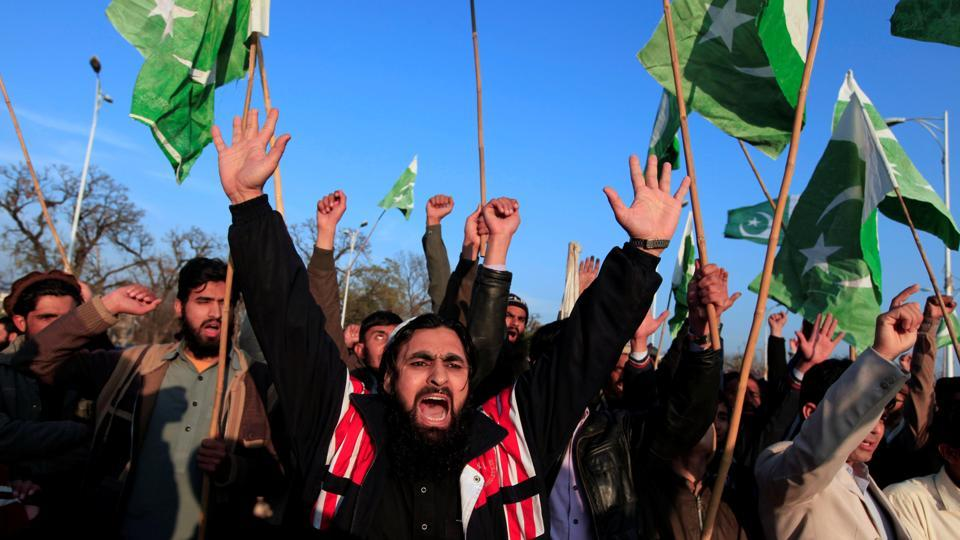 Supporters of the Jamaat-ud-Dawa (JuD) shout slogans to condemn the house arrest of the group's chief, Hafiz Saeed, during a protest in Islamabad on January 31, 2017.