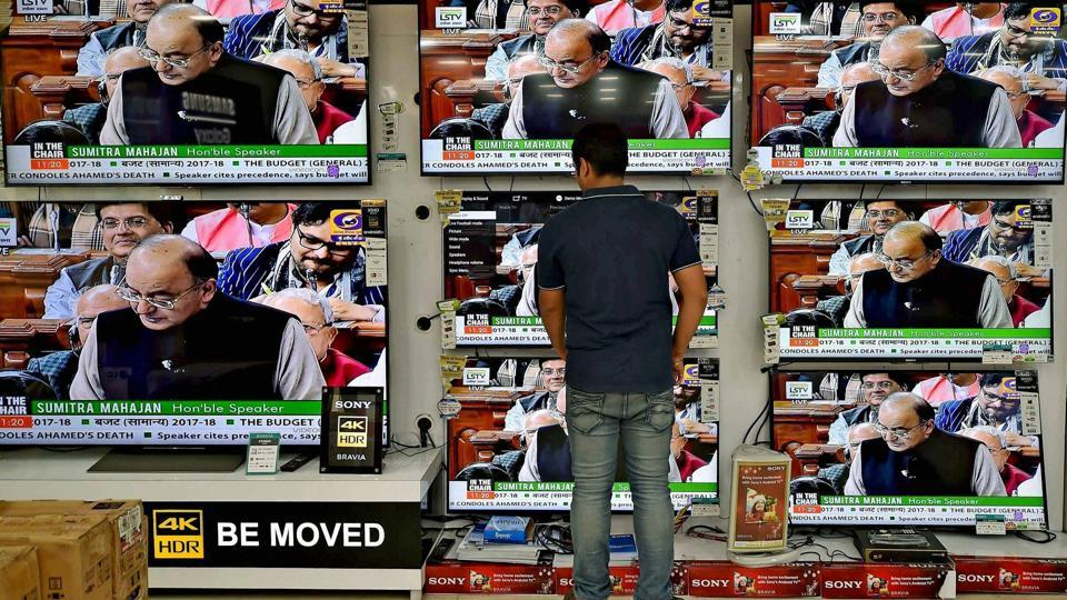 A man watches finance minister Arun Jaitley's Union Budget, on TV at a showroom in Kolkata on Wednesday.