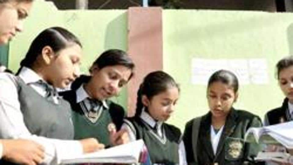 Girl students giving a last look at their notes before writing their CBSE exams at a centre in Moradabad.