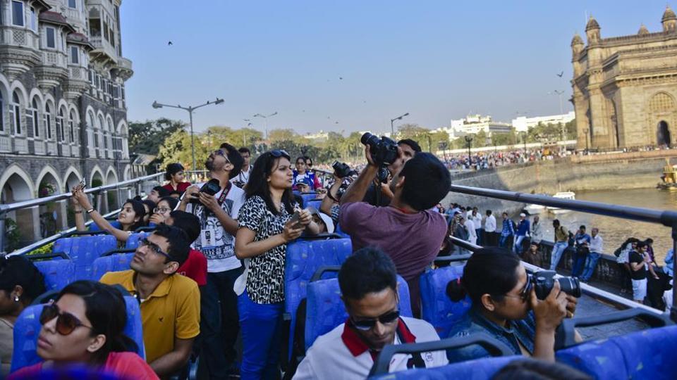 Mumbaiites enjoy  heritage bus ride during the Kala Ghoda Art Festival  last year.