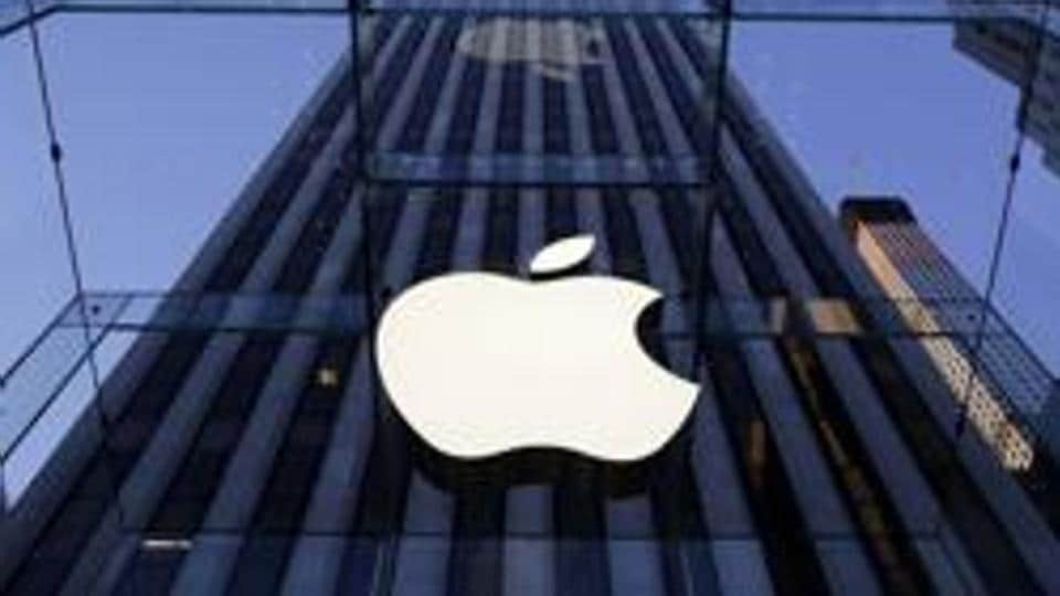 File photo of the Apple logo hangs in the glass box entrance to the company's Fifth Avenue store in New York.