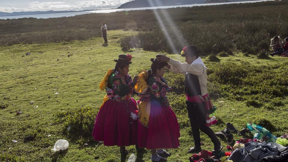 Dancers get ready near Lake Titicaca prior to their performance at Virgin of Candelaria celebrations in Puno, Peru. The festivities start this week.  (Rodrigo Abd/ AP)