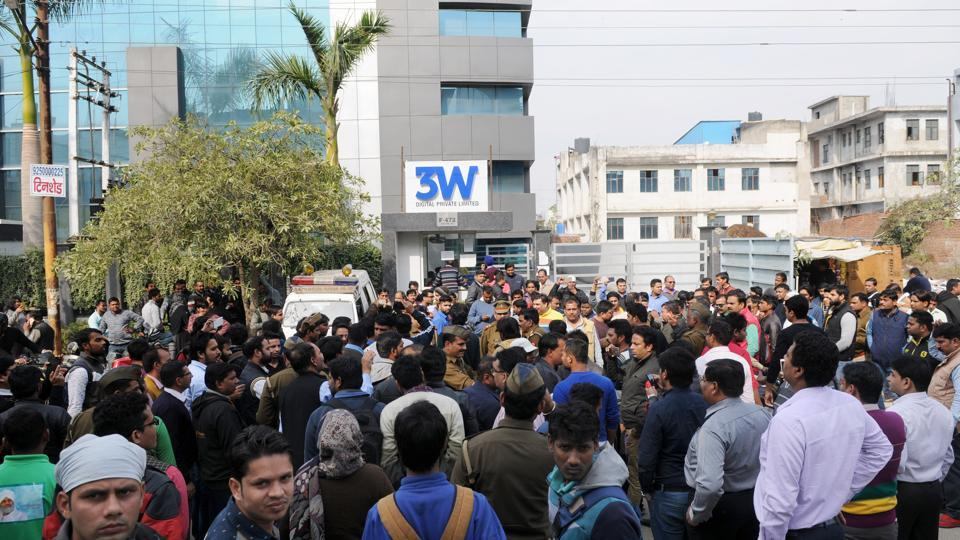 A police team tries to control the crowd outside Ablaze Info Solutions' office in Sector 63 on Thursday.