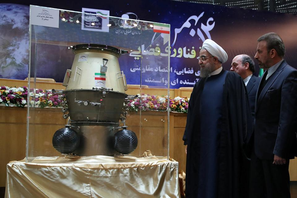 Iran's President Hassan Rouhani looks at an exhibit during a ceremony marking National Day of Space Technology in Tehran.