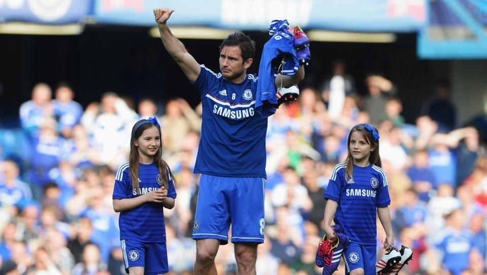 Frank Lampard of Chelsea and his daughters Luna and Isla appear on the pitch following the Premier League match between Chelsea and Norwich City, at Stamford Bridge, London on May 4, 2014.