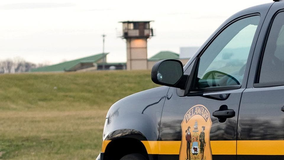 A Delaware state police vehicle overlooks the James T Vaughn Corrections Center during a lockdown where hostages were taken in an incident at the men's prison in Smyrna, Delaware.